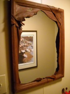 A custom deerskin wrapped mirror for a doctor's office.